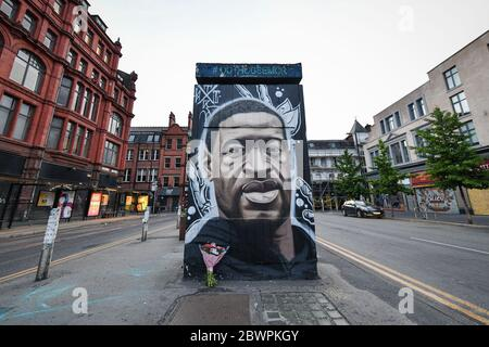 Manchester, UK. 02nd June, 2020. A freshly painted mural of the late George Floyd, has been created by the artist AKSE in Stevenson square, Manchester.A mural of the late George Floyd, created in Manchester city centre. Credit: SOPA Images Limited/Alamy Live News - Stock Photo