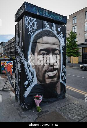 Manchester, UK. 02nd June, 2020. A tribute of flowers placed at the base a freshly painted mural of the late George Floyd, created by the artist AKSE.A mural of the late George Floyd, created in Manchester city centre. Credit: SOPA Images Limited/Alamy Live News - Stock Photo