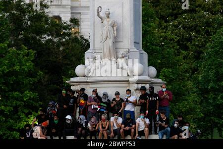 Washington Dc, Washington DC, United State of America. 2nd May, 2020. DC protesters gather around the Peace Monument in front of the Capitol Building, The protesters see a calmer night as they marched from the white house to the capitol defying the curfew. Credit: Perry Aston/ZUMA Wire/Alamy Live News - Stock Photo