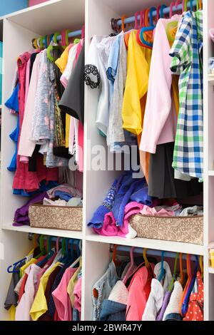 Storage of baby items in a home closet. - Stock Photo