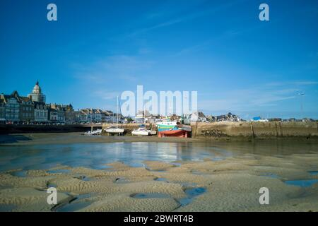Boats on the sand at low tide, village of the Croisic on Guerande peninsula, France - Stock Photo
