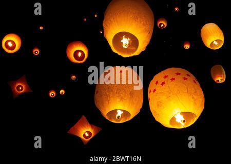 Beautiful views of lanterns being released into the dark sky during Probarona Purnima festival at Rajguru Buddhist Temple, keang mor, Bandarban, - Stock Photo