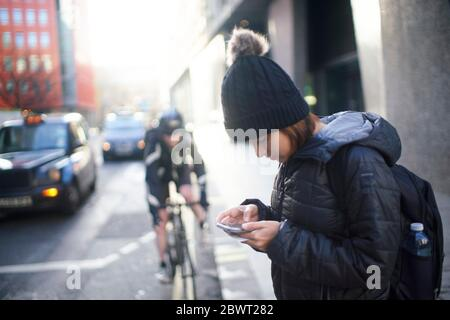 Young woman on the street, lost in the city - Stock Photo
