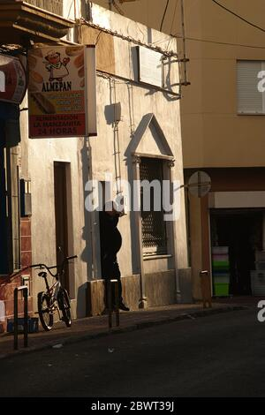 sillhouette of a man in a doorway, Tarifa, Cadiz Province, Andalucia, Spain. - Stock Photo