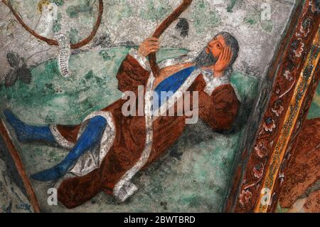 A symbolic Tree of Jesse rises from the chest of the father of David, King of Israel and Judah, in this detail of a 15th century fresco decorating a ribbed ceiling vault of the 12th century cloister adjoining the Cathedral of Santa Maria Assunta at Bressanone Brixen, South Tyrol, Trentino-Alto Adige, Italy. - Stock Photo