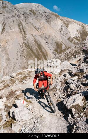 Man riding on mountainbike, Munestertal Valley, Grisons, Switzerland