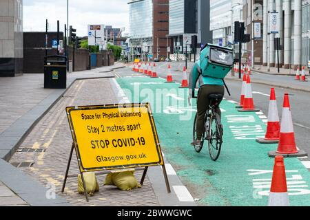 Glasgow, Scotland, UK. 3rd June, 2020. cyclists in Glasgow making use of quiet streets and existing and new cycle lanes (here shown temporary cycle lane along the Broomielaw) on World Bicycle Day 2020 Credit: Kay Roxby/Alamy Live News - Stock Photo
