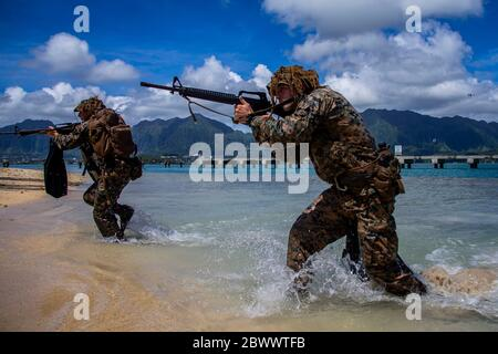 U.S. Marines with with Lima Company, 3rd Battalion, come ashore during an amphibious assault exercise, on the Mokapu Peninsula May 28, 2020 in O'ahu, Hawaii, USA. - Stock Photo