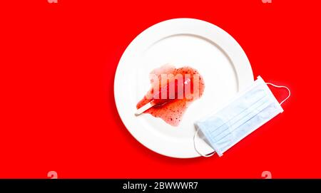 Delicious defrosted strawberry popsicles and medical mask over red background - Stock Photo