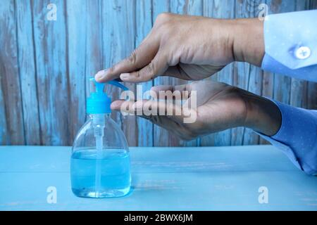 man's hands using hand sanitizer gel, healthcare and medical . - Stock Photo