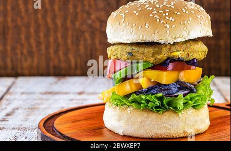 Vegetarian burger, Sandwich made without meat. It can be made from corn, potatoes, textured soy protein, legumes, tofu, mushrooms or cereals. - Stock Photo