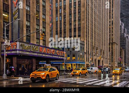 New York City, U.S.A, May 2019, facade of the Radio City Music Hall building on a rainy day - Stock Photo