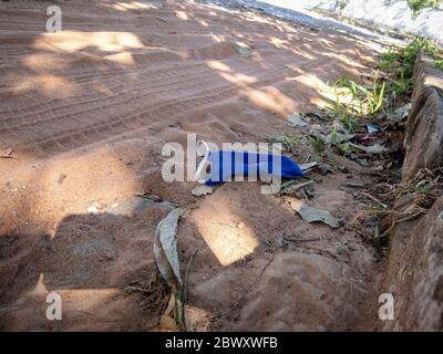 Asuncion, Paraguay. 3rd June, 2020. A protective face mask is seen discarded on the ground during the outbreak of the coronavirus disease (COVID-19) in a neighborhood in Asuncion, Paraguay. Credit: Andre M. Chang/ZUMA Wire/Alamy Live News - Stock Photo
