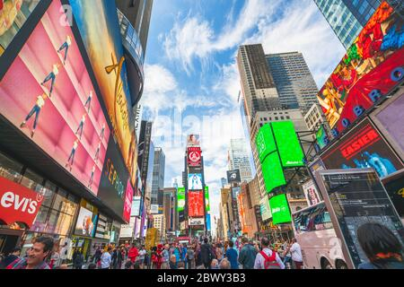 New York City/USA - May 24, 2019  Times Square, one of the world's most visited tourist attractions. Crowded street, brightly lit by billboards and ad