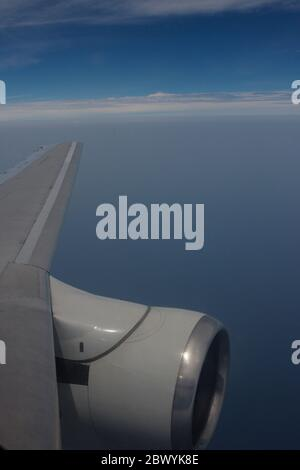 Aircraft engine viewed from the window of a Boeing 737-200 aircraft flying above 33000 feet. - Stock Photo