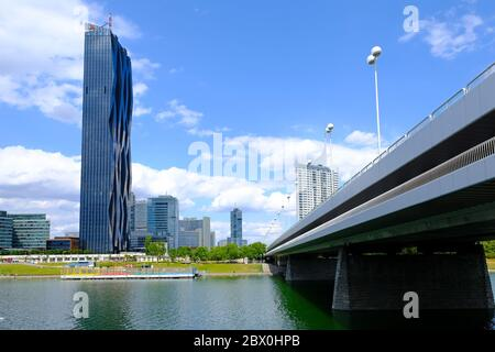 VIENNA, AUSTRIA - JULY 9, 2019: Skyline of Donau City, seen from the right bank of the Danube, near the Empire Bridge. DC-Tower is the tallest skyscra