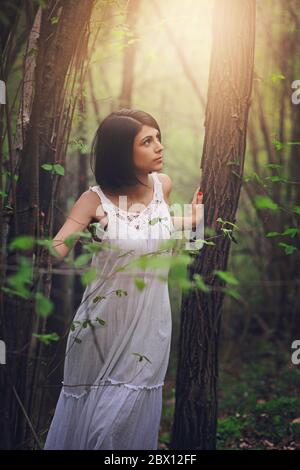 Beautiful woman walking in the woods . Soft light - Stock Photo