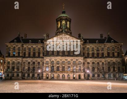 Amsterdam May 18 2018 -The old city hall and now the royal palace. Build by Napoleon in the 1800s by night - Stock Photo