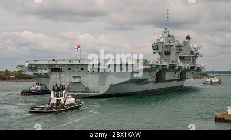 The Royal Navy aircraft carrier HMS Queen Elizabeth (R08) returned to Portsmouth, UK on the 4th June 2020 to embark personnel from 617 Squadron (The Dambusters) along with their equipment to support an air wing of F-35B Lightning II fighter aircraft. The ship will then sail and lead a carrier strike group in an exercise named Crimson Ocean. The F-35B aircraft and accompanying helicopters will most likely join the ship once she is back at sea. - Stock Photo