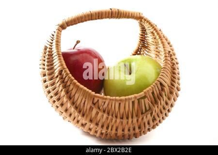 Red and green apple in basket on white background - Stock Photo