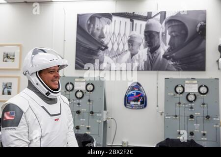 NASA astronaut Robert Behnken, smiles as he suits-up in his SpaceX spacesuit, in the ready room of the Neil Armstrong Operations and Checkout Building at the Kennedy Space Center May 30, 2020 Cape Canaveral, in Florida. The astronauts Behnken and Hurley will make a second attempt at launch in the first commercial launch carrying astronauts to the International Space Station. - Stock Photo