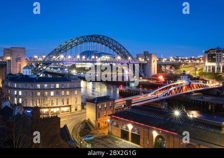 Newcastle Swing Bridge, Tyne Bridge and River Tyne at night, Newcastle Upon Tyne, Tyne & Wear England, UK - Stock Photo