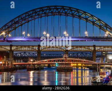 The Tyne Bridge, High Level Bridge and River Tyne at night, Newcastle Upon Tyne, Tyne & Wear, England, UK - Stock Photo