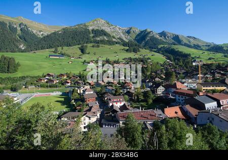 Switzerland, canton of Vaud, country of Enhaut, Goldenpass train, passage to Chateau d'Oex, the village seen from the hill of the church