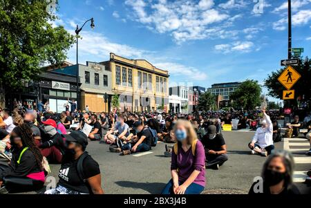 Washington, DC, USA - June 2, 2020:  Protesters observe a moment of silence at a demonstration against the murder of George Floyd by police - Stock Photo