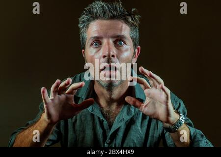 shock and surprise facial expression portrait of young hypnotized and mesmerized man feeling shocked and surprised looking something stunned with mout