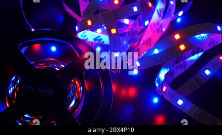 Led stripe and diod coil - purple light on black background - Stock Photo