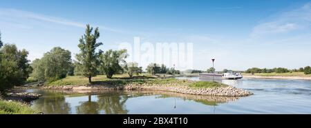 ship in river ijssel between arnhem and deventer in the netherlands - Stock Photo