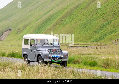 MOFFAT, SCOTLAND - JUNE 29, 2019: 1964 Austin Gipsy 4x4 in a classic car rally en route towards the town of Moffat, Dumfries and Galloway - Stock Photo