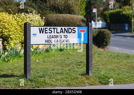Street name sign with no through road symbol in England, UK. - Stock Photo