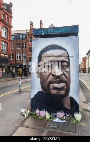 Black Lives Matter - Tribute painted mural by street artist Akse of George Floyd in Northern Quarter, Manchester, England - Stock Photo
