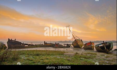 Boat wrecks at Pin Mill, on the river Orwell in Suffolk - Stock Photo