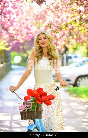 Travel concept. Riding bicycle. Girl and sakura blossom. Cycling Tours. Bike ride adventure. Urban excursion. Cherry tree blooming. Woman ride retro bicycle. Bike ride tours. Summer vacation. - Stock Photo