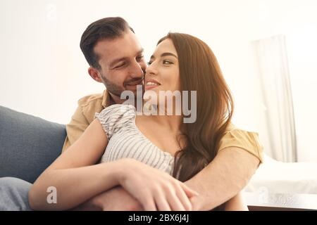 Beautiful couple in love having romantic date at home - Stock Photo