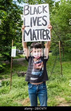 New York City, New York, USA - May 31, 2020: Peaceful protest demanding justice for the death of George Floyd, through Prospect Park, organized by Park Slope families, Brooklyn , New York City, USA. - Stock Photo