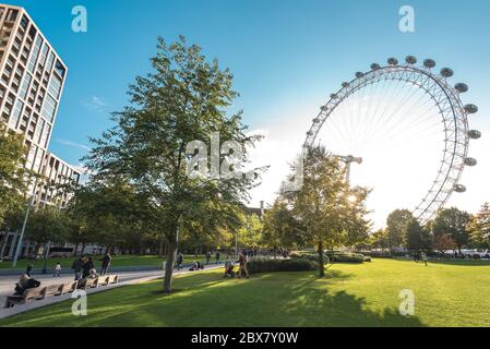London, UK - October 19, 2019: View of the Coca-Cola London Eye observation wheel from the Jubilee park during sunset. - Stock Photo
