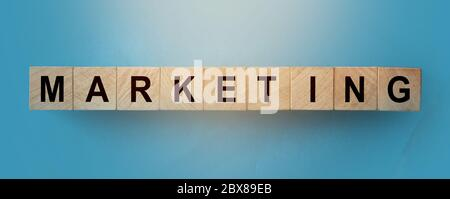 Marketing word written on wood block. Business promotion and brand desing concept
