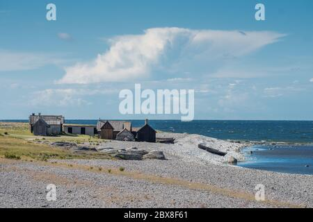 Helgumannens fishing village on Fårö island in the Baltic sea. Fårö on Gtland is a popular travel destination at summertime in Sweden. - Stock Photo