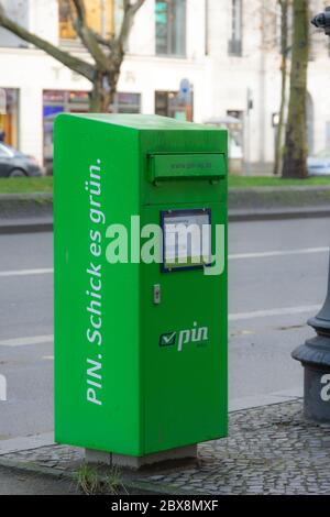 Post box from PIN AG after the rain in Berlin