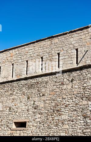 Castello del Buonconsiglio or Castelvecchio Medieval castle in Trento city. Fortified wall with the arrow slits. Trentino Alto Adige, Italy - Stock Photo
