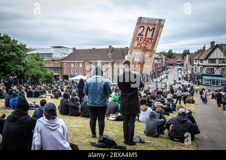 Protesters and demonstrators gather for BLM, Black Lives Matter protest and rally in hill in Hitchin, Hertfordshire, UK
