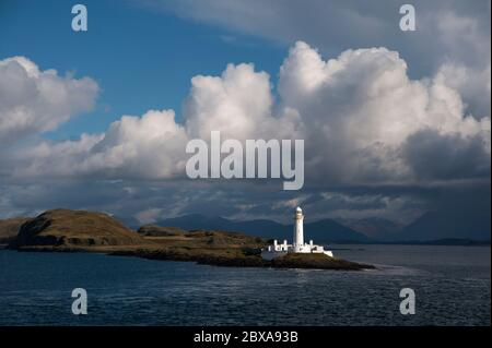 Eilean Musdile lighthouse at the southern tip of the Isle of Lismore viewed from the Oban to Craignure, Mull ferry - Stock Photo