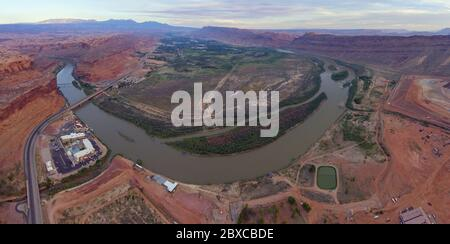 Aerial view of Colorado River and La Sal Mountains panorama at sunset near Arches National Park in Moab, Utah, USA. - Stock Photo