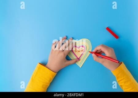 paper craft fathers day card, kids made paper kids hand drowing heart on card
