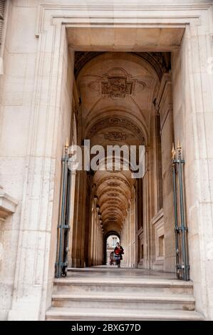 The covered passages of the Louvre Museum are spectacular vaulted arched ceilings that are a breathtaking sight to the visitor of Paris, France. - Stock Photo