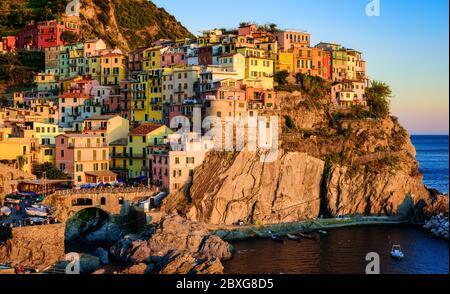 Manarola village in Cinque Terre, on Mediterranean coast of Liguria, Italy, in sunset light